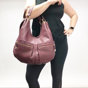 Michael Kors purple leather zipper hobo purse bag
